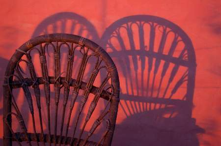 Chairs and shadows at sunset