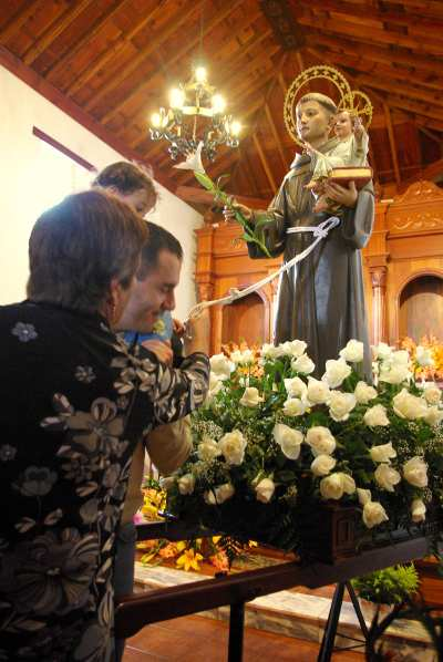 Touching the statue of St Antony's belt for a blessing, San Antonio del Monte, Garafia, La Palma