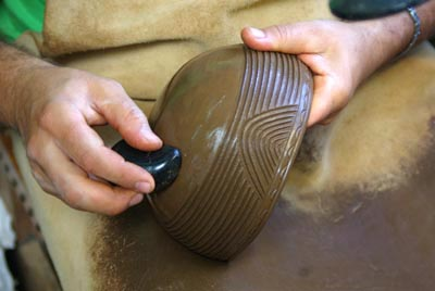 Smoothing the base of a replica bowl